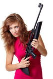 Sexy Action Girl with gun. Isolated over white Royalty Free Stock Photography