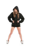 And adorable female wearing a black hoodie. On white background royalty free stock image