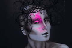 Sexy adult female with neon powred on face Stock Photos