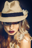 Sexy adult girl with nice makeup in stylish hat looking down Stock Photos