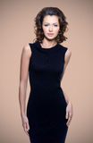 Sexy adult woman in black dress Royalty Free Stock Photography
