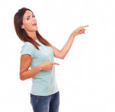 Sexy adult woman pointing to her left Royalty Free Stock Image
