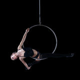 Sexy aerial dancer hanging on hoop isolated Royalty Free Stock Photo