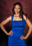 African American fashion model. Curvy African American fashion model in formal blue vibrant dress stock photos