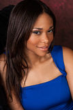 African American fashion model. Curvy African American fashion model in formal blue vibrant dress stock photo