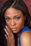 Sexy African American fashion model skin and nail care. Royalty Free Stock Image