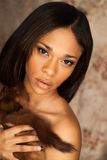 Sexy African American fashion model wearing a fox fur Stock Image