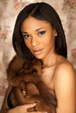 Sexy African American fashion model wearing a fox fur Royalty Free Stock Photography