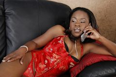 Sexy African American woman on cell phone Royalty Free Stock Images