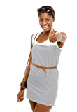 Sexy African American woman holding thumbs up white background Stock Image