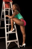 Sexy African-American woman in lingerie by ladder Stock Photos