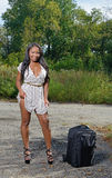 Sexy African-American woman in sundress with suitcase - travel Royalty Free Stock Images