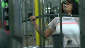 African-american woman working out at the gym. Brunette african-american woman working out at the gym stock footage
