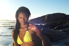 Sexy african american woman in yellow bikini at the beach Stock Image