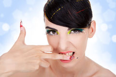 Sexy aggressive woman biting her middle finger Stock Images