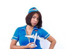 Sexy air hostess holds model scale aircraft Royalty Free Stock Photos