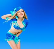 Sexy air stewardess. Hostess. Sexy beauty stewardess in blue uniform on blue sky background Stock Photography