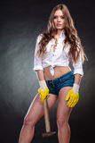 Sexy alluring woman holding hammer. Feminism. Royalty Free Stock Photography