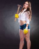 Sexy alluring woman holding hammer. Feminism. Royalty Free Stock Photos