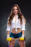 Sexy alluring woman holding hammer. Feminism. Stock Photo