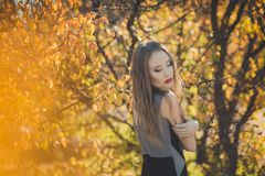 Amazing lady girl nifty stylish dressed in autumn jacket with blond hairs and pout red lips with make up face posing sit for. Camera in central park spring stock image