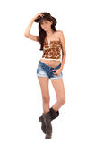 Sexy american cowgirl with shorts and boots and a cowboy hat. Royalty Free Stock Photo