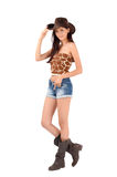 American cowgirl with shorts and boots and a cowboy hat. Cowgirl with shorts and boots and a cowboy hat. Isolated on white background stock photography