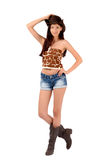 American cowgirl with shorts and boots and a cowboy hat. Cowgirl with shorts and boots and a cowboy hat. Isolated on white background stock photos