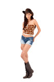 American cowgirl with shorts and boots and a cowboy hat. Cowgirl with shorts and boots and a cowboy hat. Isolated on white background royalty free stock images