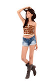 American cowgirl with shorts and boots and a cowboy hat. Cowgirl with shorts and boots and a cowboy hat looking away. Isolated on white background royalty free stock photography
