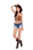 Sexy amerikanisches Cowgirl mit kurzen Hosen und Stiefel und ein Cowboyhut. Lizenzfreie Stockfotografie