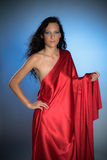 Sexy ancient goddess in red satin Stock Images