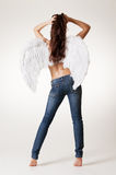 Sexy angel in jeans. Posing against white background Stock Photos