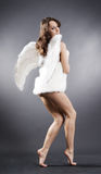 Sexy angel in white furs Stock Photo