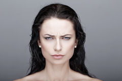 Sexy annoyed brunette woman Royalty Free Stock Images