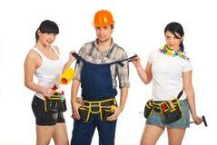 Sexy arbeidersvrouwen met werkman Stock Fotografie