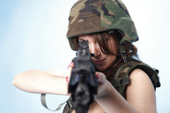 Sexy army woman. With assault rifle Stock Photography