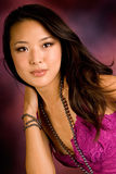 Sexy asian brunette. Fashion model wearing pink in the studio Royalty Free Stock Photos