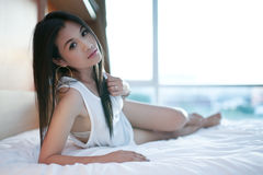 Sexy asian girl on bed Royalty Free Stock Photos