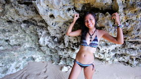 Sexy Asian Girl at Exotic Beach Lean Against Rock stock video footage