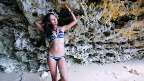 Sexy Asian Girl at Exotic Beach Lean Against Rock stock video