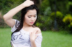 Sexy Asian girl is getting wet Stock Photos