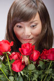 asian girl smelling roses Royalty Free Stock Photo