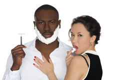 Sexy asian  licking foam from dark men with razor. Sexy asian women licking the foam from his cheeks dark-skinned men with razor isolated on white Stock Image