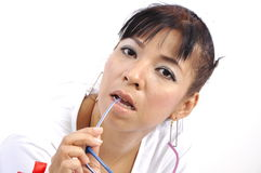 Sexy Asian nurse glasses between her teeth Stock Photography