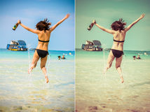 Sexy Asian Thai girl in bikini is jumping with joy on the seasho Royalty Free Stock Photo