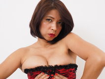 Sexy Asian woman in corset Stock Images