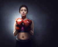 Sexy asian woman with defence stance Royalty Free Stock Images