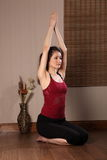 Asian woman in keep fit exercise routine Royalty Free Stock Photo