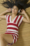 Sexy Asian woman listening to music Royalty Free Stock Photography